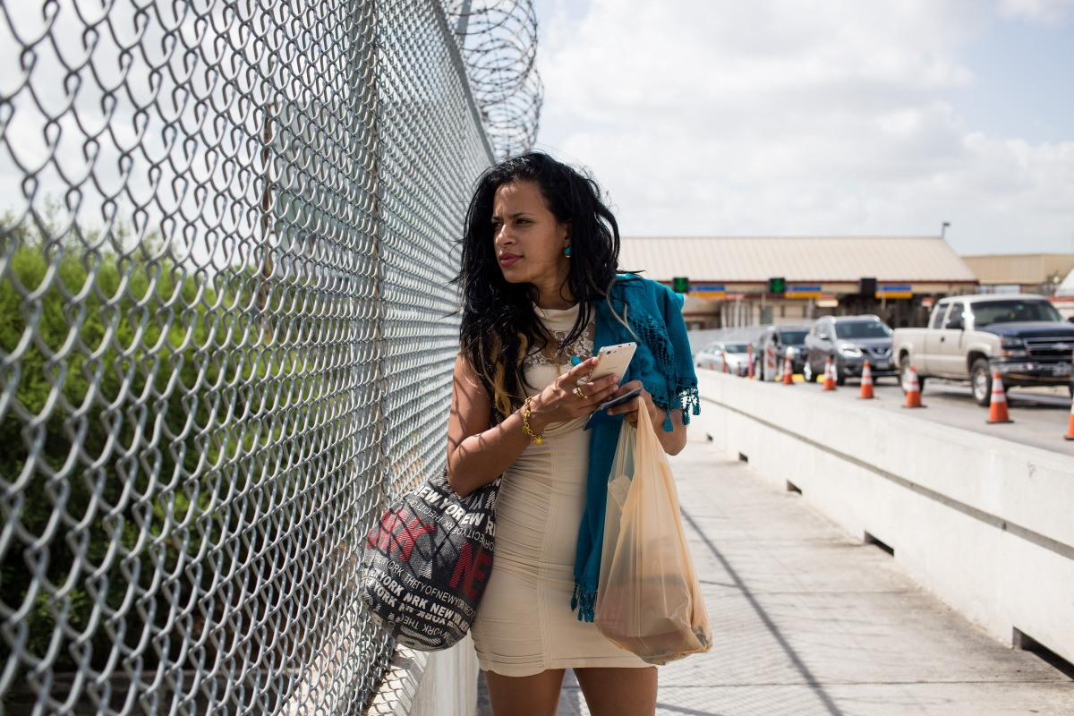 After taking buses through Honduras and Guatemala, Liset flew from southern Mexico to Matamoros, near Brownsville, Texas. On July 2, she walks along the bridge over the Rio Grande to present herself to officials and seek asylum.