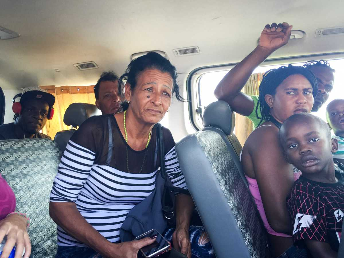 Marta rides in a van with Haitian migrants after being detained by Peruvian migration officials on May 24. They were released after an officer took a liking to Liset and decided to let her go.
