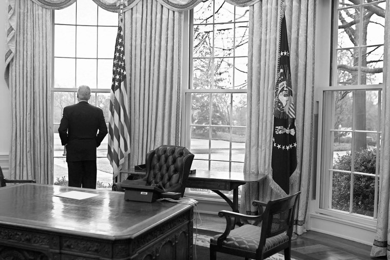 President Clinton takes one final look before exiting the Oval Office for the last time. the only things on his desk are the phone and a note to incoming President Bush, January 20, 2001.