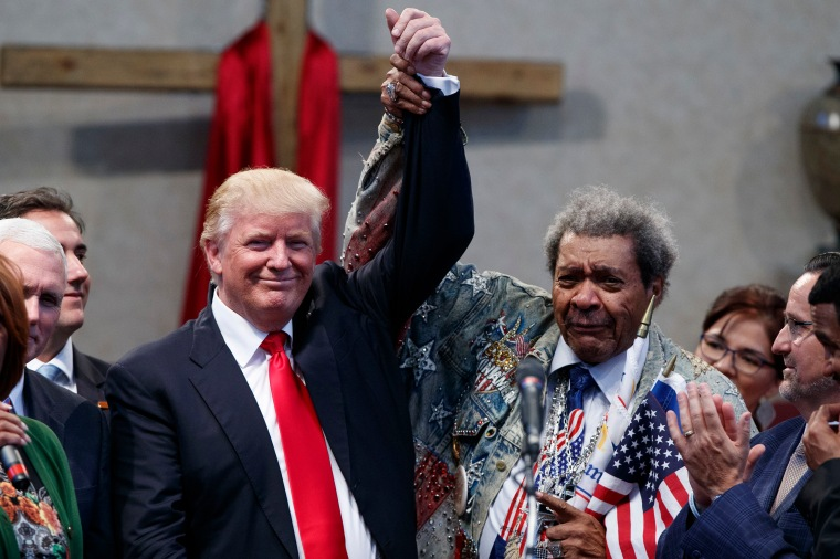 Boxing promoter Don King holds up the hand of Donald Trump during a visit to the Pastors Leadership Conference at New Spirit Revival Center, on Sept. 21, 2016, in Cleveland, Ohio.