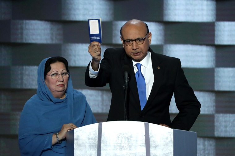Khizr Khan, father of deceased Muslim U.S. Soldier Humayun S. M. Khan, holds up a booklet of the US Constitution as he delivers remarks on the fourth day of the Democratic National Convention at the Wells Fargo Center, July 28, 2016 in Philadelphia.