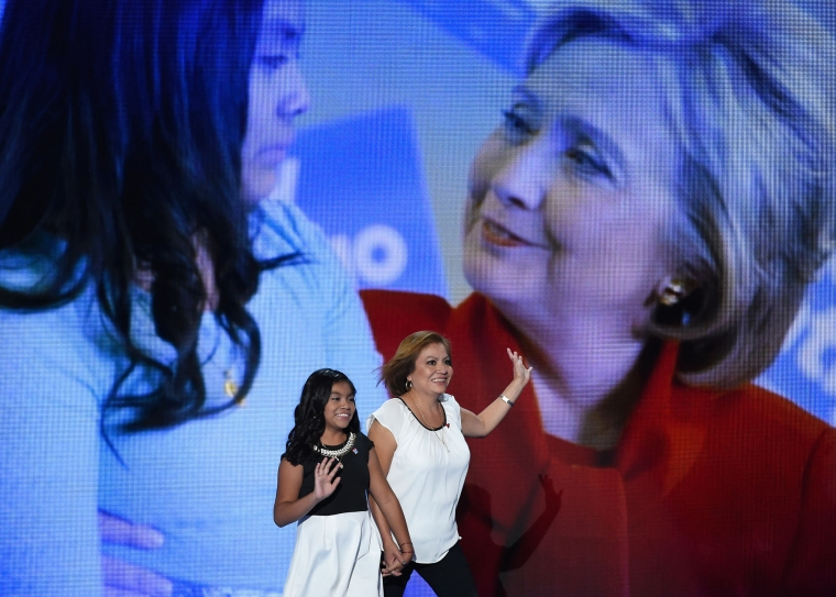 Karla Ortiz arrives on stage with her mother Francisca Ortiz during Day 1 of the Democratic National Convention at the Wells Fargo Center on July 25, 2016, in Philadelphia.