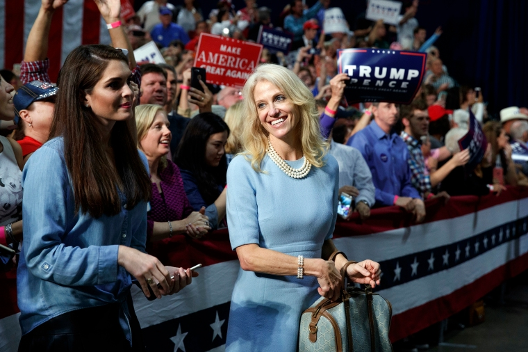 Kellyanne Conway, campaign manager for Donald Trump, and press secretary Hope Hicks watch during a campaign rally, on Oct. 14, 2016, in Charlotte, N.C.