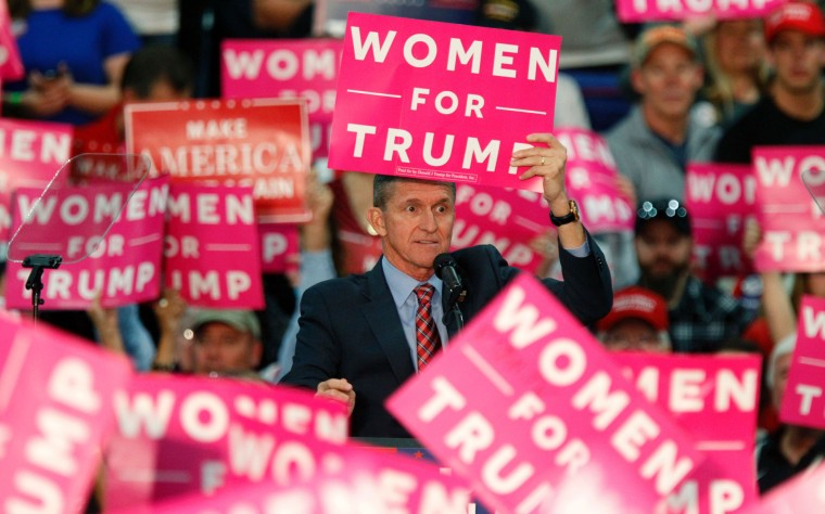 Retired Lt. General Michael Flynn holds up a sign while speaking to the crowd gathered to see Donald Trump at The Champions Center Expo, on Oct. 27, 2016, in Springfield, Ohio.