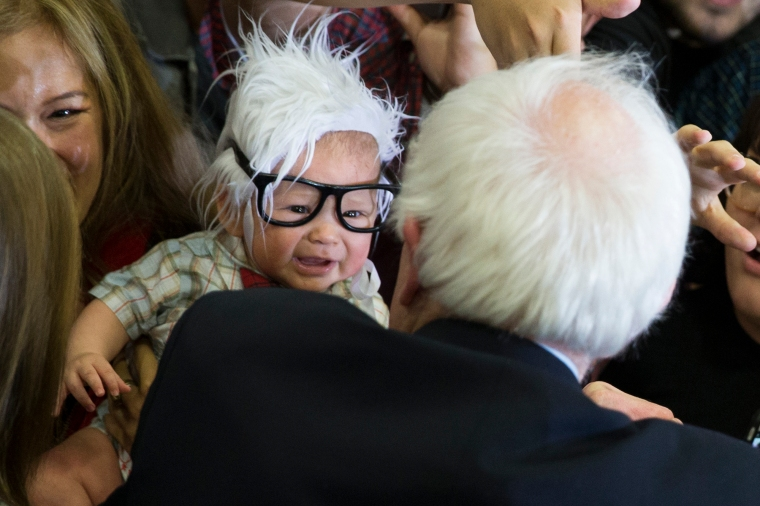 Bernie Sanders meets 3-month-old Oliver Jack Carter Lomas-Davis, of Venice, Calif., who was dressed as Sanders during a rally at Bonanza High School on Feb. 14, 2016 in Las Vegas.