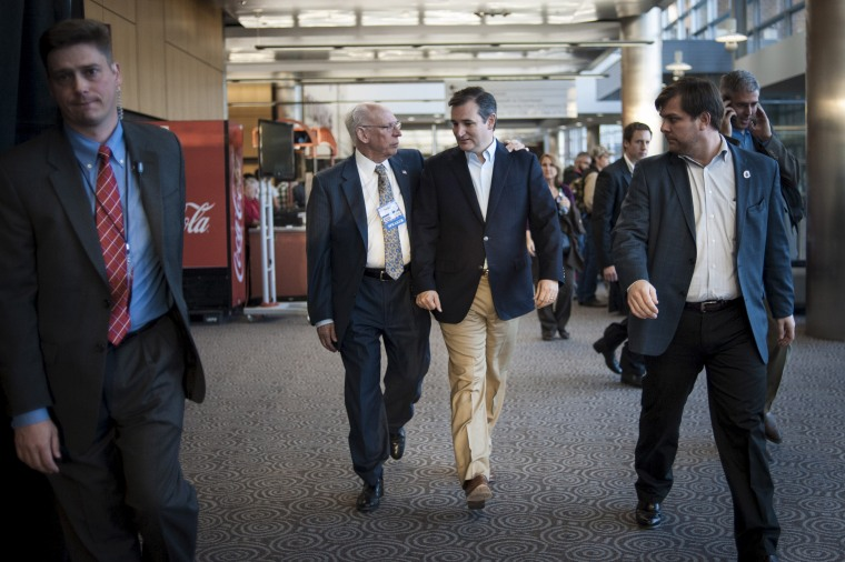 Ted Cruz speaks with his father Rafael Cruz at the Freedom 2015 National Religious Liberties Conference, on Nov. 6, 2015, in Des Moines, Iowa.