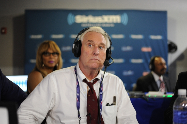 Former Donald Trump Advisor, Roger Stone, listens to host Jonathan Alter talk during an episode of Alter Family Politics on SiriusXM at Quicken Loans Arena on July 20, 2016, in Cleveland.