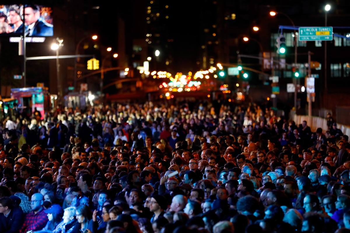 People wait for results outside the Jacob K. Javits Convention Center where Hillary Clinton is holding her election night event, on Nov. 8, 2016 in New York City.