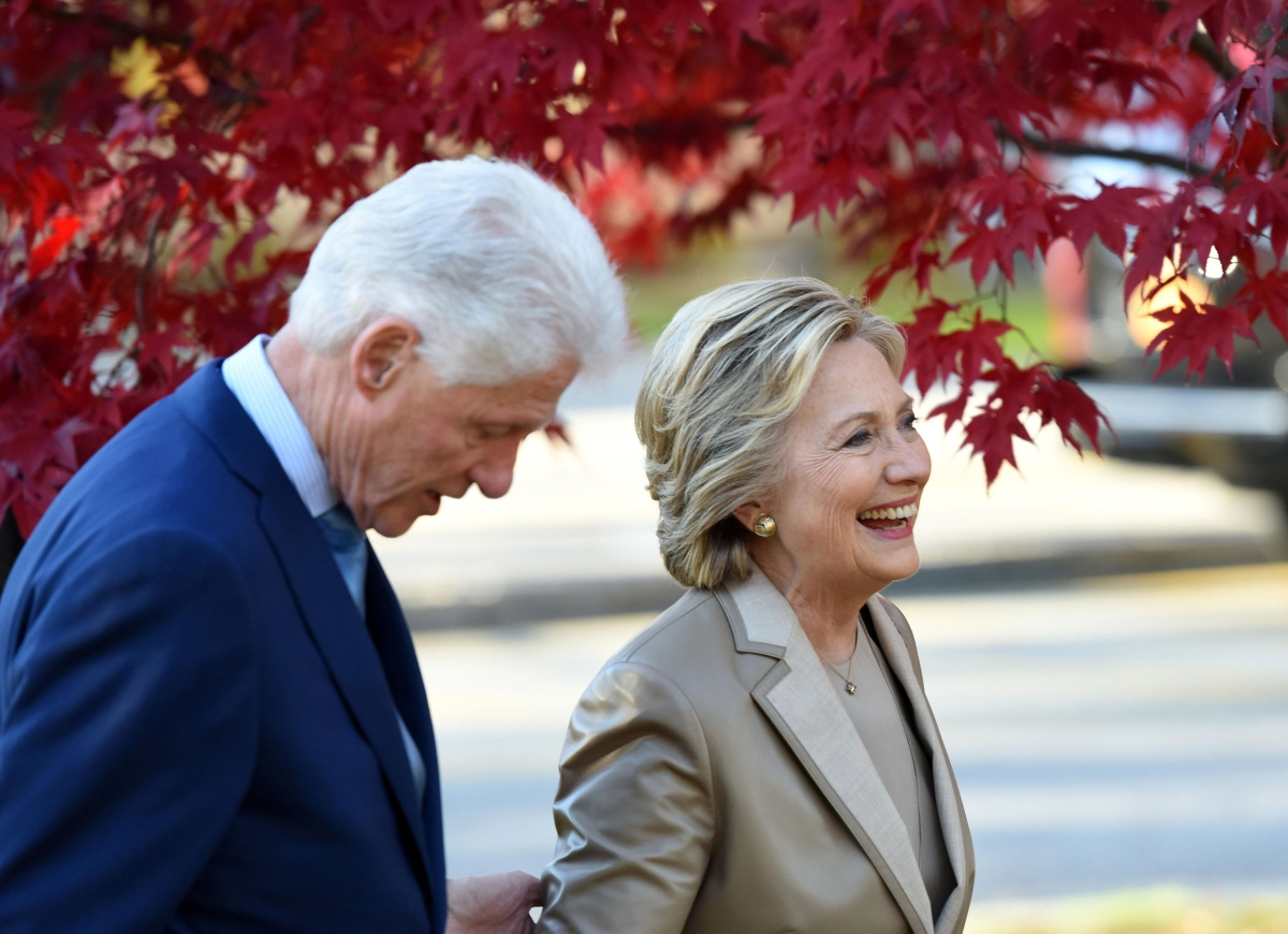 Hillary Clinton and her husband Bill Clinton leave after casting their ballots at a polling station, on Nov. 8, 2016, in Chappaqua, New York.