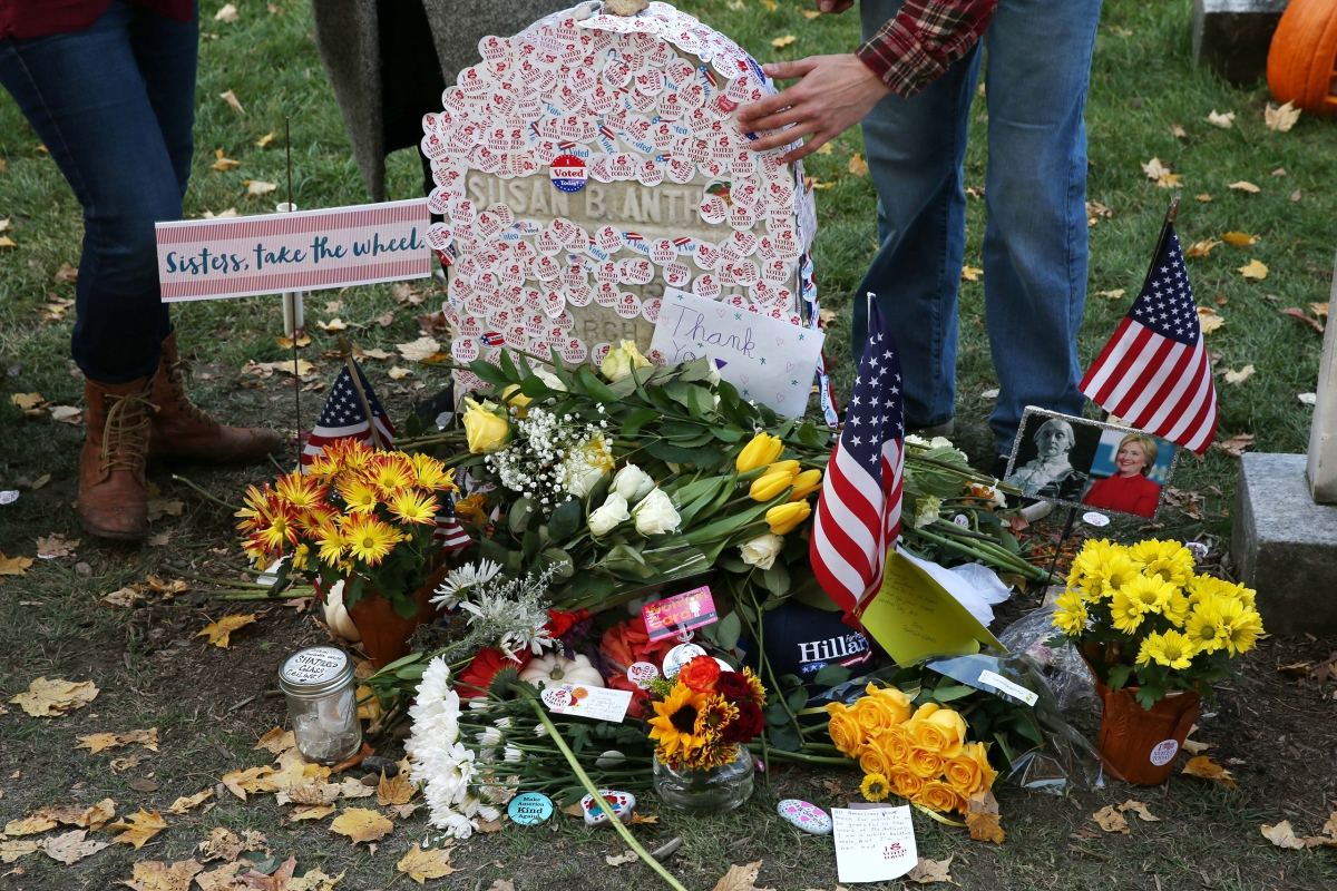 "Voters lined up on election day to place ""I voted"" stickers on the grave of Susan B. Anthony at Mt. Hope Cemetery, on Nov. 8, 2016 in Rochester, NY."