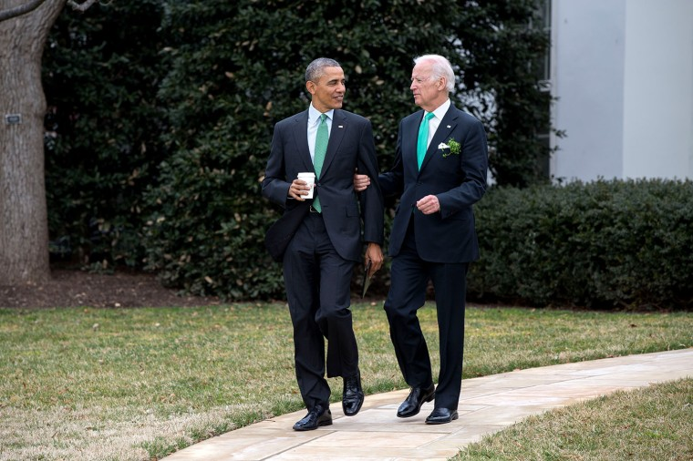 President Barack Obama and Vice President Joe Biden walk to the motorcade on the South Lawn of the White House for departure en route to the U.S. Capitol in Washington, D.C. for a St. Patrick's Day lunch, March 17, 2015. (Official White House Photo by Pete Souza)This official White House photograph is being made available only for publication by news organizations and/or for personal use printing by the subject(s) of the photograph. The photograph may not be manipulated in any way and may not be used in commercial or political materials, advertisements, emails, products, promotions that in any way suggests approval or endorsement of the President, the First Family, or the White House.