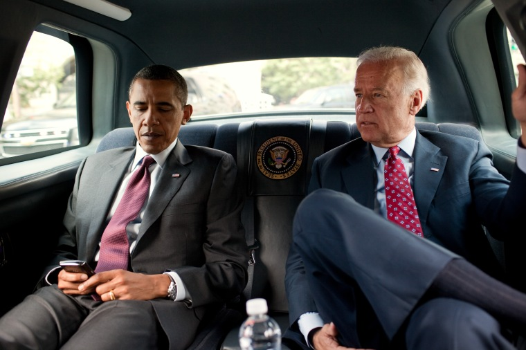President Barack Obama and Vice President Joe Biden ride in the motorcade from the White House to the Ronald Reagan Building in Washington, D.C., July 21, 2010, to sign the Dodd-Frank Wall Street Reform and Consumer Protection Act. (Official White House Photo by Pete Souza)This official White House photograph is being made available only for publication by news organizations and/or for personal use printing by the subject(s) of the photograph. The photograph may not be manipulated in any way and may not be used in commercial or political materials, advertisements, emails, products, promotions that in any way suggests approval or endorsement of the President, the First Family, or the White House.