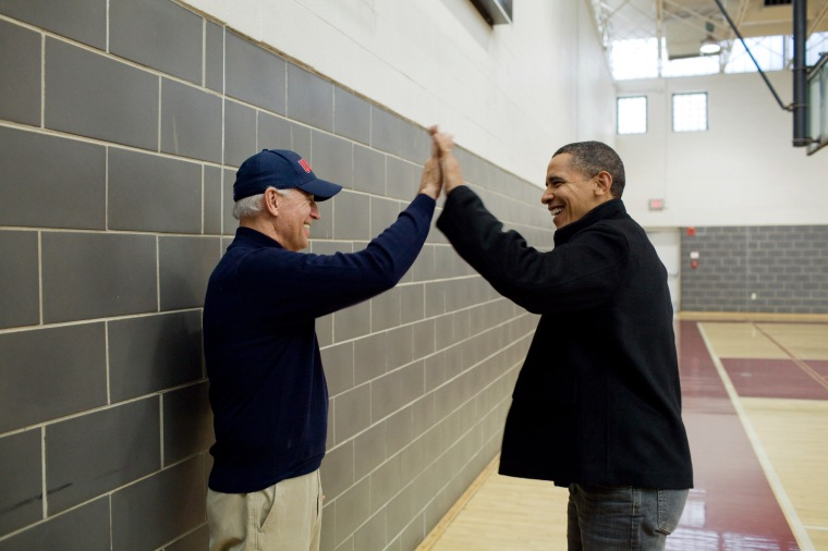 President Barack Obama and Vice President Joe Biden high-five after watching Sasha Obama and Maisy Biden play in a basketball game in Chevy Chase, Md., Feb. 27, 2010. (Official White House Photo by Pete Souza)This official White House photograph is being made available only for publication by news organizations and/or for personal use printing by the subject(s) of the photograph. The photograph may not be manipulated in any way and may not be used in commercial or political materials, advertisements, emails, products, promotions that in any way suggests approval or endorsement of the President, the First Family, or the White House.