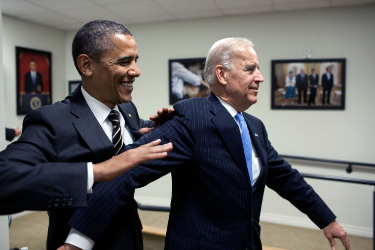 President Barack Obama jokes with Vice President Joe Biden backstage before the STOCK Act signing event in the Eisenhower Executive Office Building South Court Auditorium, April 4, 2012. (Official White House Photo by Pete Souza)This official White House photograph is being made available only for publication by news organizations and/or for personal use printing by the subject(s) of the photograph. The photograph may not be manipulated in any way and may not be used in commercial or political materials, advertisements, emails, products, promotions that in any way suggests approval or endorsement of the President, the First Family, or the White House.