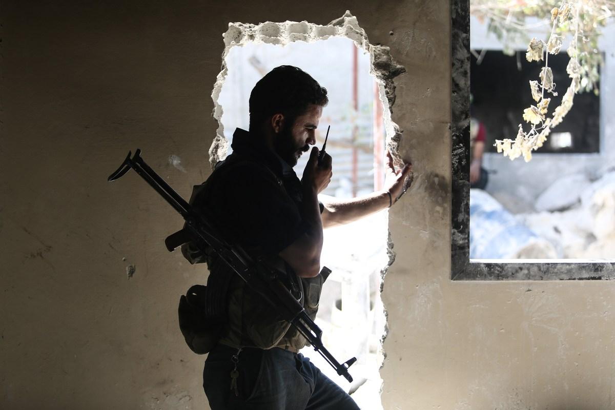 An opposition fighter communicates via radio in Douma on Sept. 5. Mohammed Badra—EPA