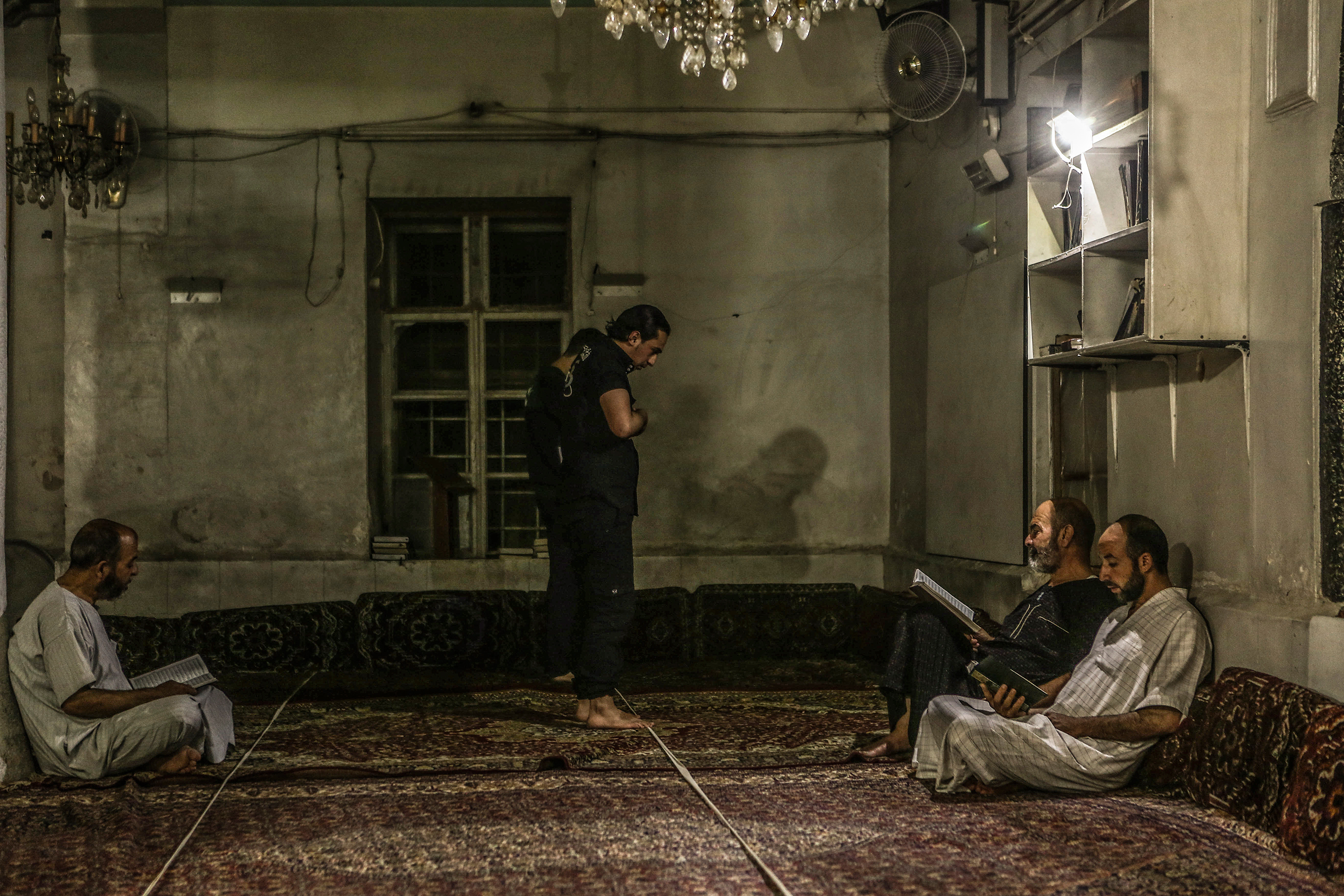 Men pray in a mosque in Eastern Ghouta province on July 2. Mohammed Badra—EPA