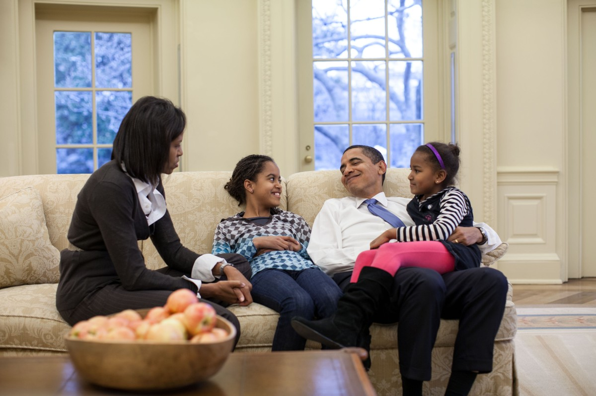 In this official White House photograph, President Barack Obama, First Lady Michelle Obama and daughters Malia and Sasha sit together in the Oval Office, Feb. 2, 2009.