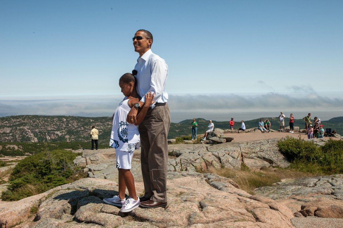 In this official White House photograph, President Barack Obama and daughter Sasha stand atop Cadillac Mountain in Acadia National Park, Maine, July 16, 2010.