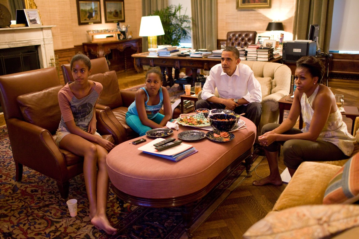 In this official White House photograph, President Barack Obama and his daughters Sasha and Malia watch the World Cup soccer game between the U.S. and Japan, from the Treaty Room office in the residence of the White House, July 17, 2011.