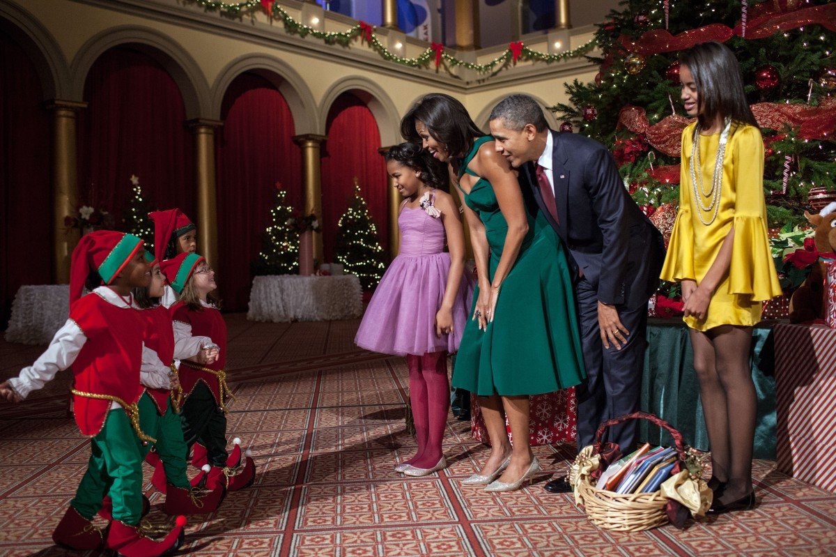 In this official White House photograph, President Barack Obama, First Lady Michelle Obama, daughters Sasha and Malia, attend the Christmas in Washington taping at the National Building Museum in Washington, D.C., Dec. 11, 2011.