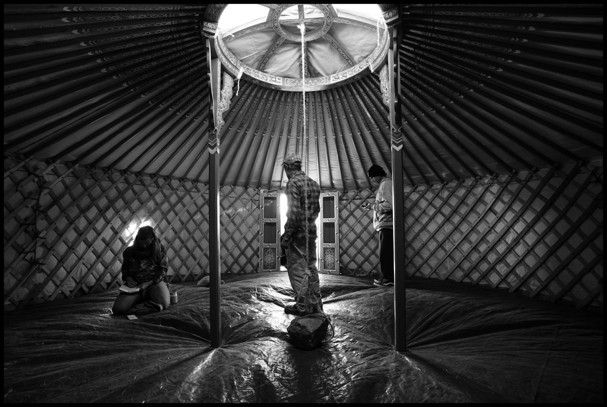 People take cover inside a yurt at the Standing Rock camp in North Dakota on Nov 10, 2016. Protesters have set up teepee and tent camps on land owned by Energy Transfer Partners to slow the progress of construction and have threatened to block the highway.