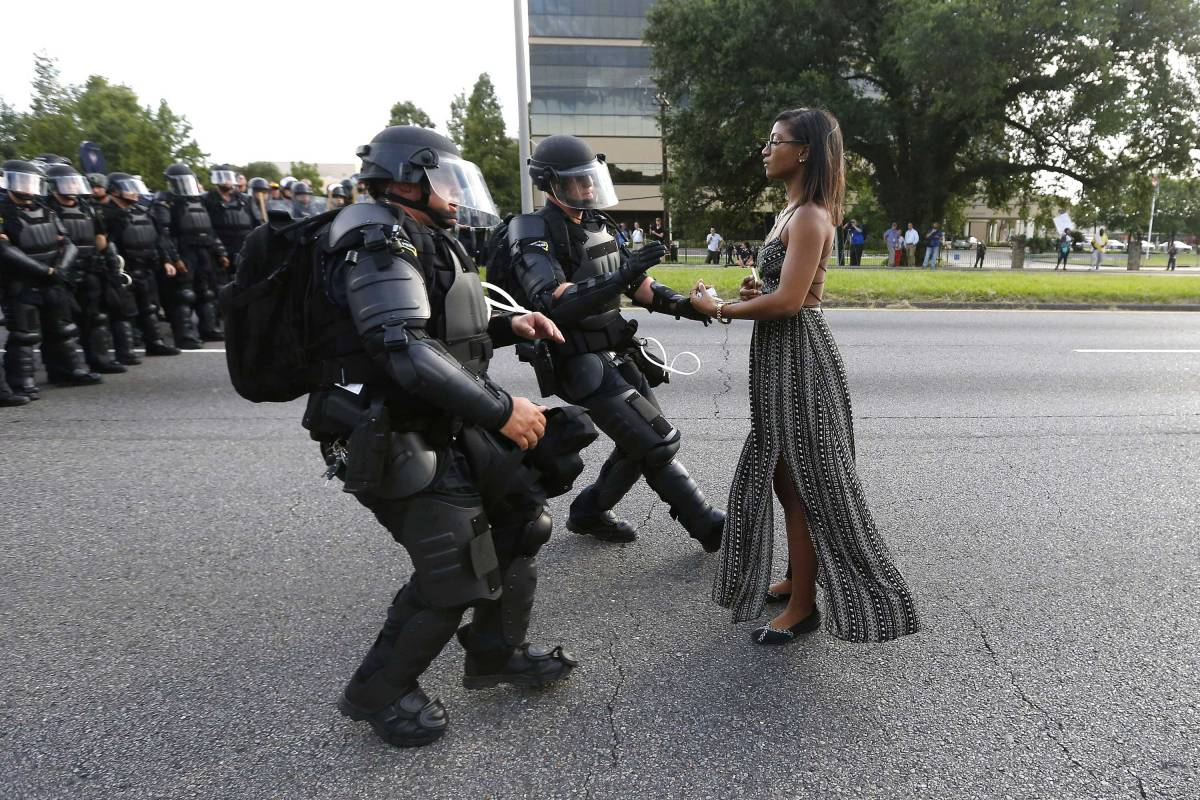 A demonstrator, named Ieshia Evans, protesting the shooting death of Alton Sterling is detained by law enforcement near the headquarters of the Baton Rouge Police Department in Baton Rouge, La, on July 9, 2016.