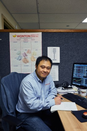 New Fortune Cookie writer, James Wong, at his desk working. Wonton Food Inc. Brooklyn, New York. Jan. 18th, 2017