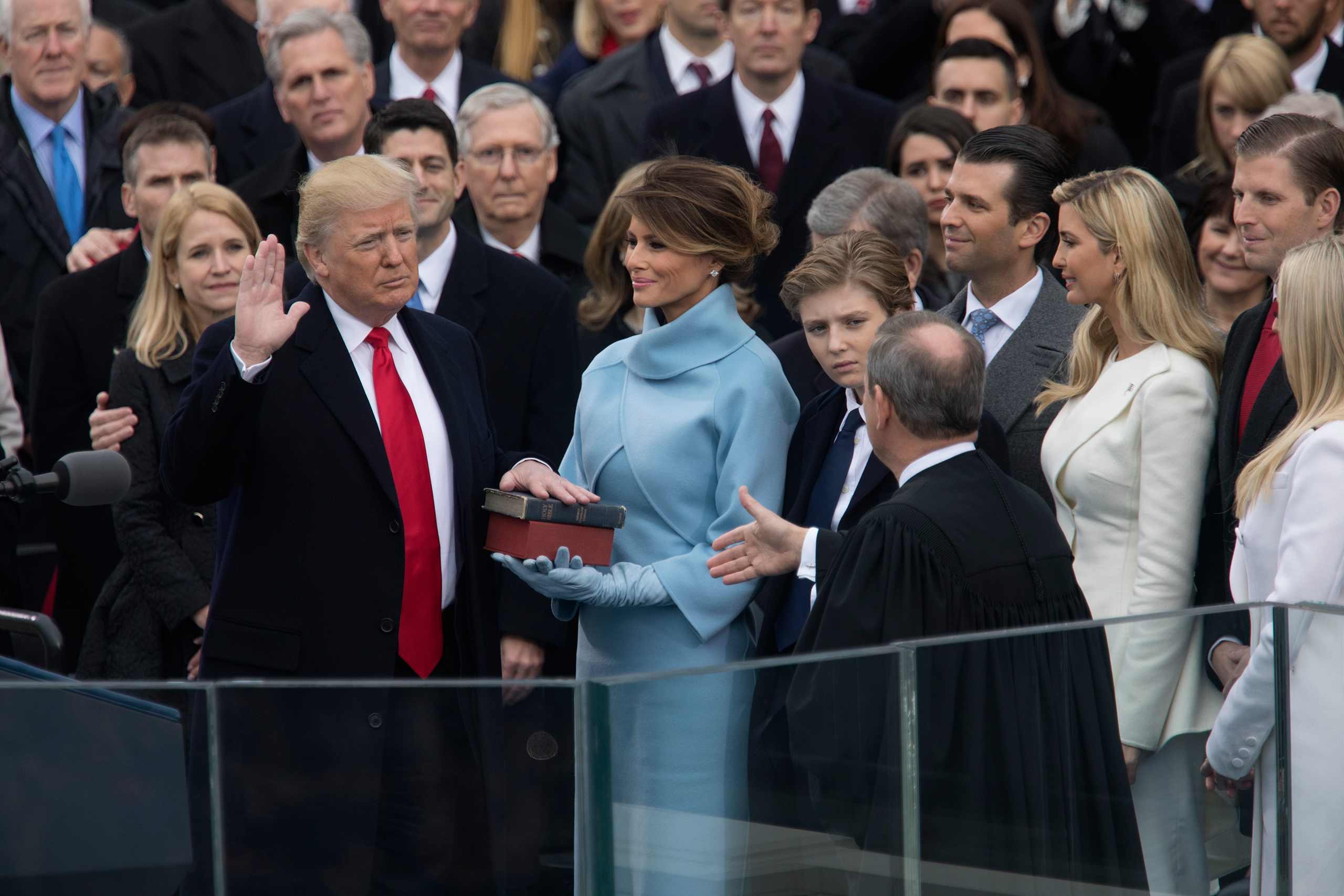 President Donald Trump takes the oath of office alongside his wife, Melania, at the Capitol in Washington on Jan. 20, 2017.
