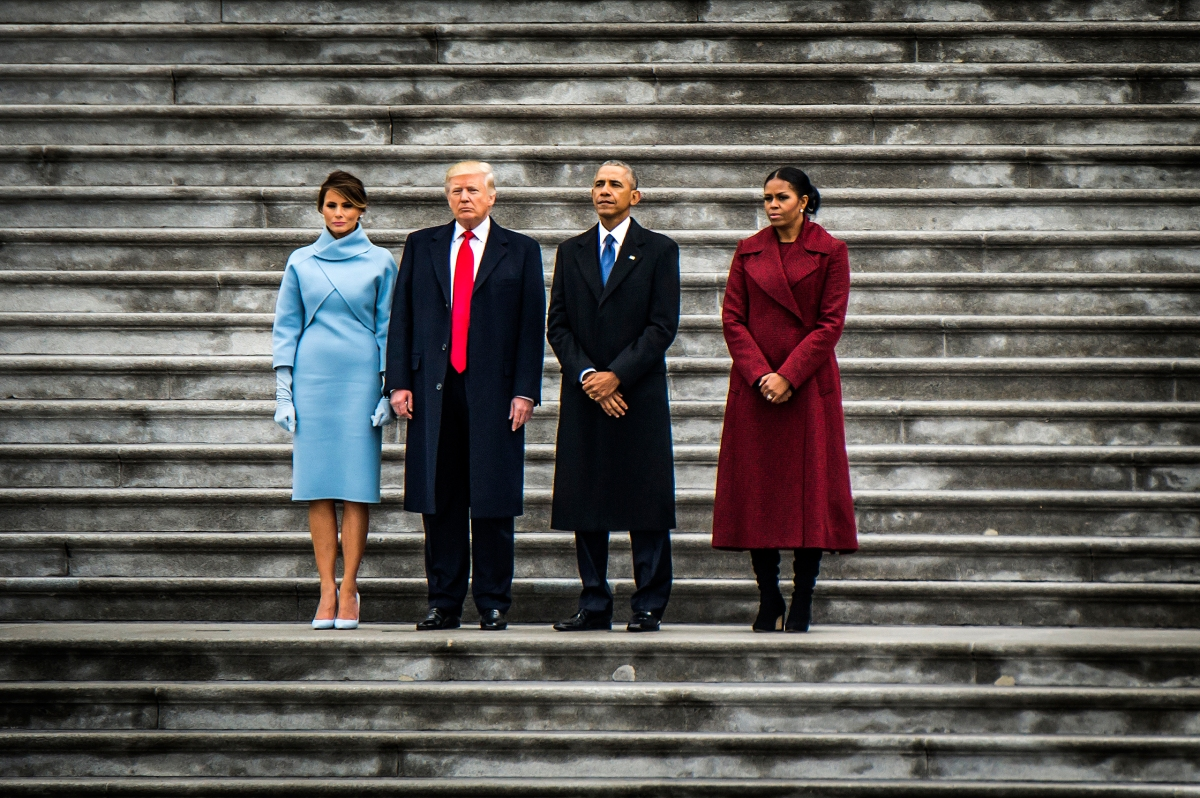 President Donald Trump and First Lady Melania Trump join former President Obama and former First Lady Michelle Obama before the Obamas leave the Capitol on a helicopter following Trump's inauguration on Jan. 20, 2017.