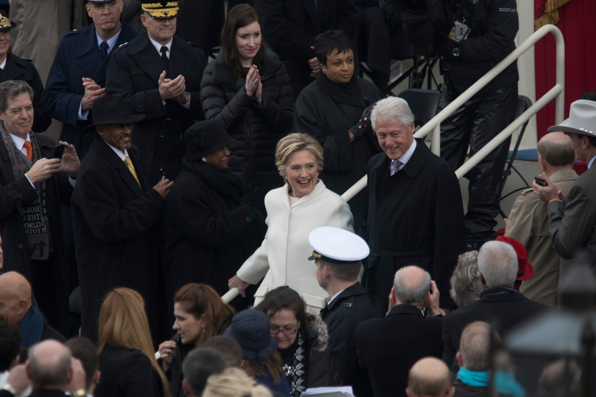 Hillary Clinton, the Democratic nominee who lost the 2016 election to Donald Trump, and former President Bill Clinton arrive on the Capitol stage for the inauguration on Jan. 20, 2017.