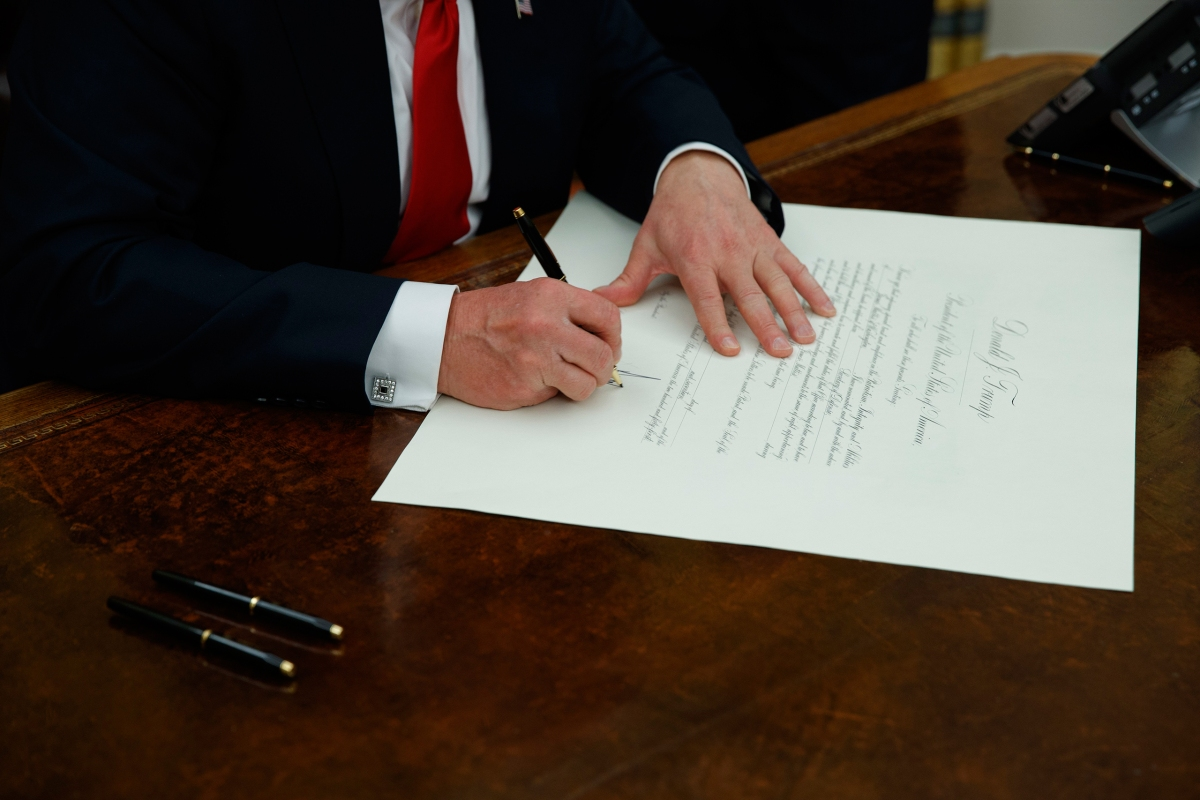 President Donald Trump signs a confirmation for Defense Secretary James Mattis in the Oval Office of the White House in Washington on Jan. 20, 2017.
