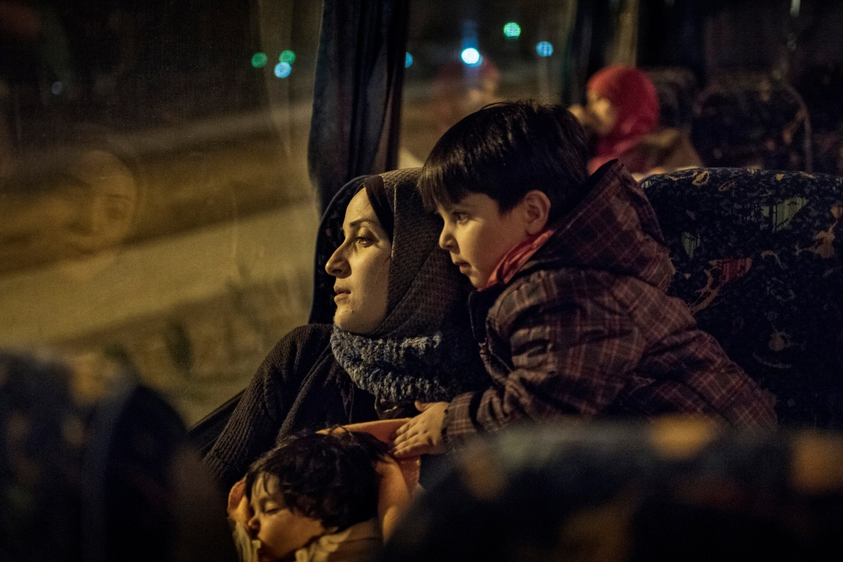 Taimaa Abazli, a Syrian refugee, with her baby Heln and son Wael, take an overnight bus to Athens, where they will learn which country will grant them asylum, Jan. 19, 2017.Taimaa Abazli, a Syrian refugee, with her baby Heln and son Wael, on a 10-hour bus ride from Thessaloniki to Athens where they await news about their placement in Europe.