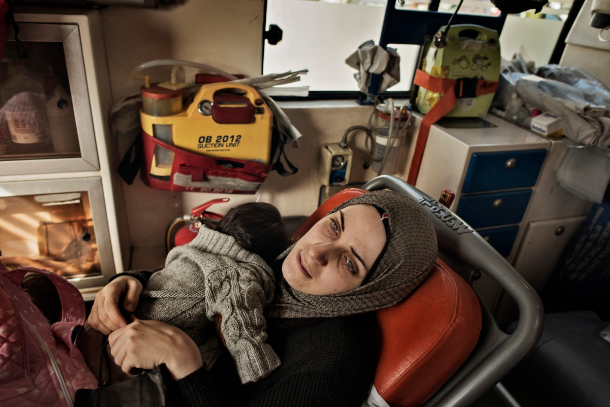 Taimaa and her daughter, Heln, ride in a Greek ambulance to the hospital in Athens as Heln, who was diagnosed with an acute bronchial infection before they left Thessaloniki, became sicker during their journey to Athens, Jan. 21, 2017.
