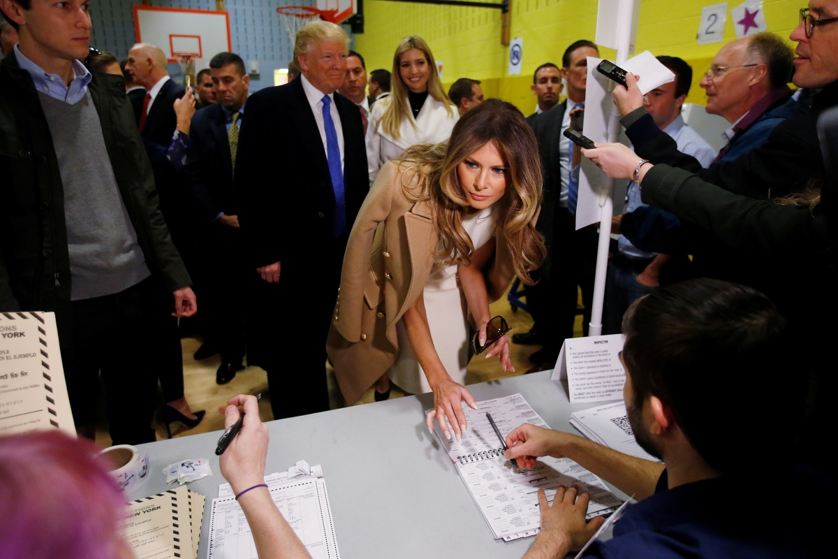 Melania Trump signs her name before she votes at PS 59 in New York, on Nov. 8, 2016.