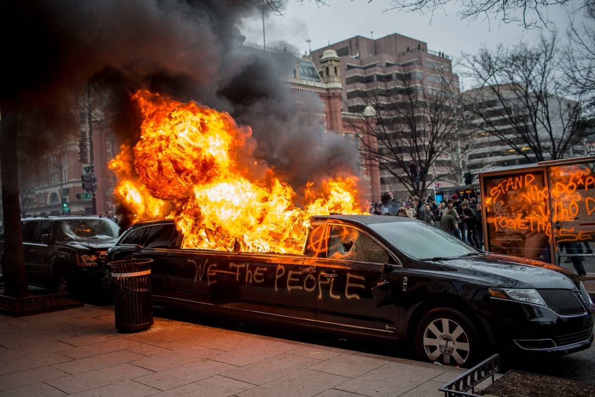 In the afternoon on Jan. 20 after President Trump was inaugurated, one group of protesters near 13th and K in Washington, D.C., took their rage to the streets. A few cars were smashed and this limo was set on fire before police used stun grenades and pepper spray to disperse the crowd and put out the flames once again.