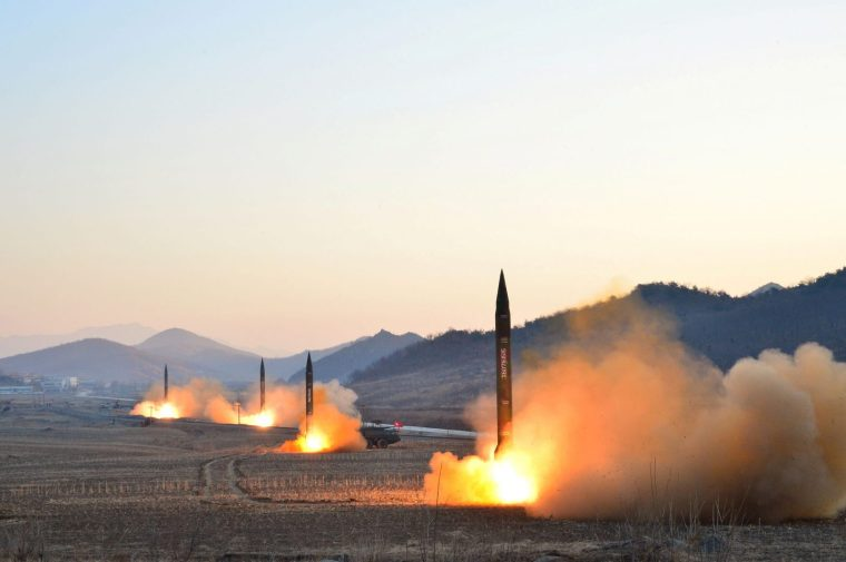 North Korea conducts a ballistic rocket-launching drill in an undated photo released March 7.