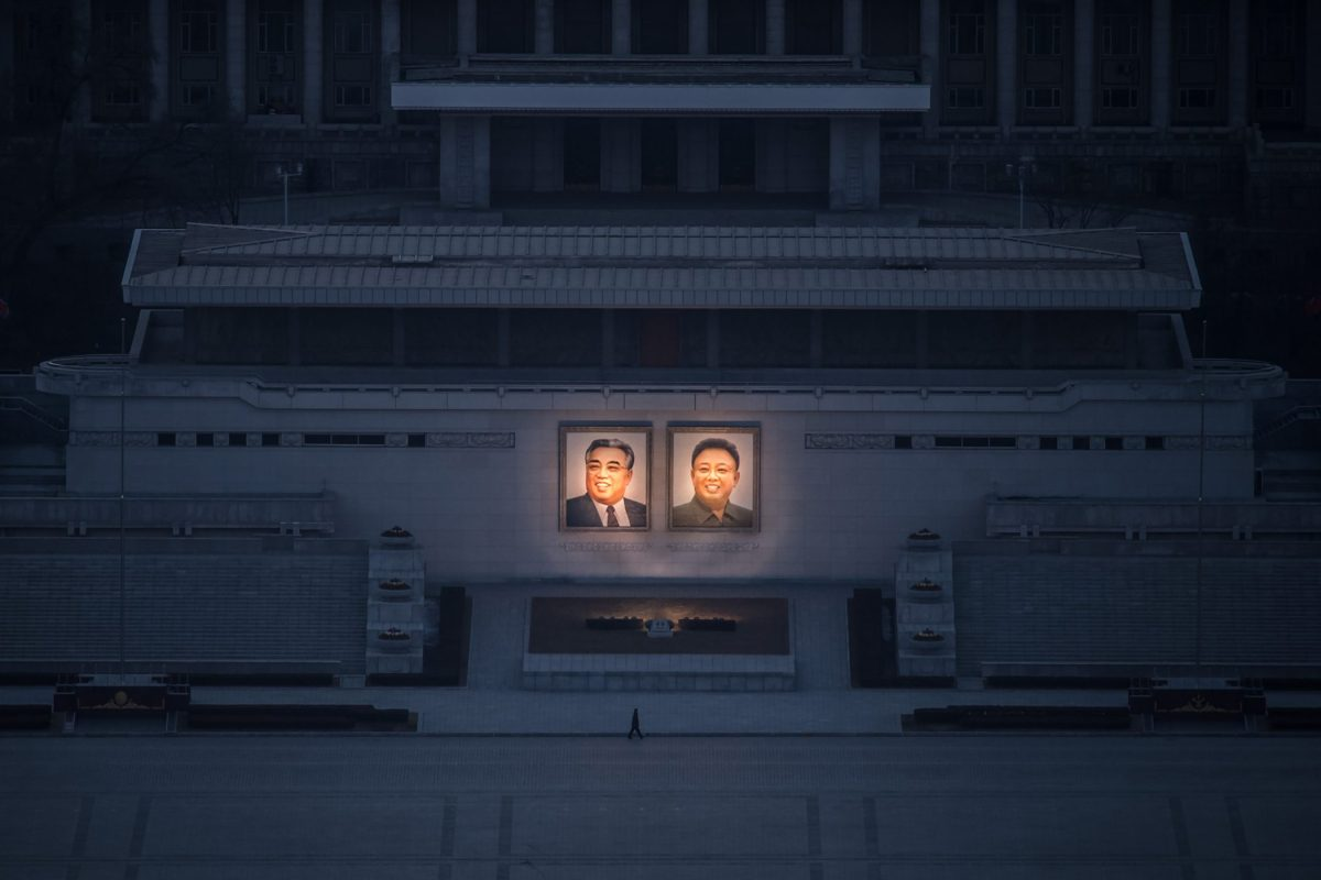 A pedestrian passes portraits of the late Kim Il Sung, left, and Kim Jong Il in Pyongyang on Feb.Ã' 17.