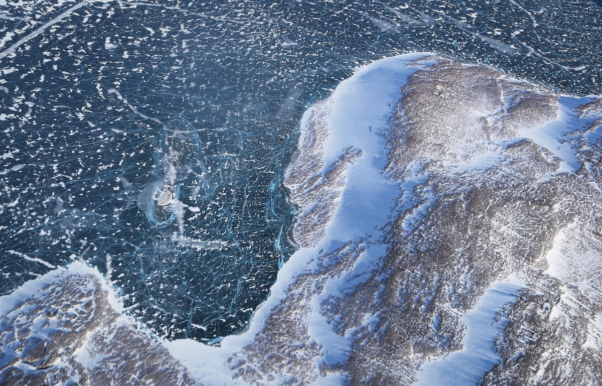 Sea ice meets land along the Upper Baffin Bay coast above Greenland on March 27, 2017.