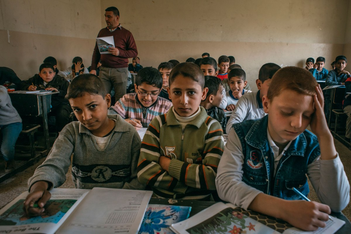 A group of boys during a classroom lesson at the Zahret Al-Mada'en school in eastern Mosul on April 2.