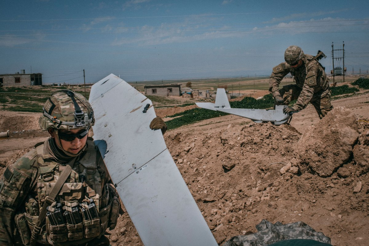 U.S. soldiers recover a Puma drone after a surveillance mission over western Mosul on April 6.
