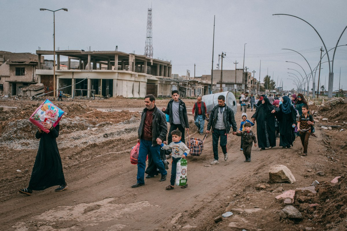 Civilians return via Baghdad Road to a liberated neighborhood in southwest Mosul on March 31.
