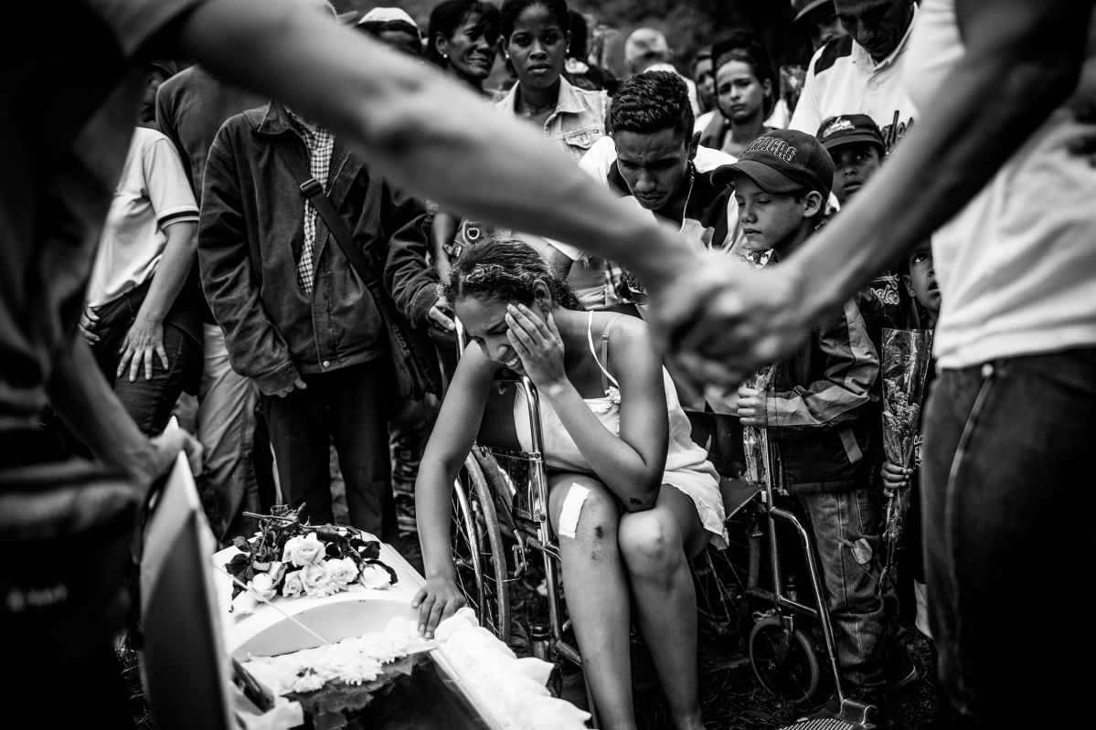 A young boy's funeral after a grenade explosion. Alejandro Cegarra