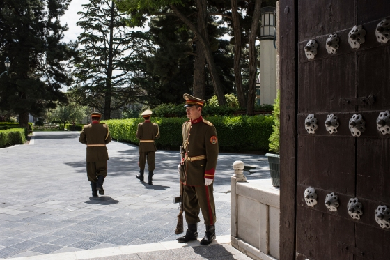 A presidential guard stands watch inside the palace compound in Kabul on May 11, 2017.