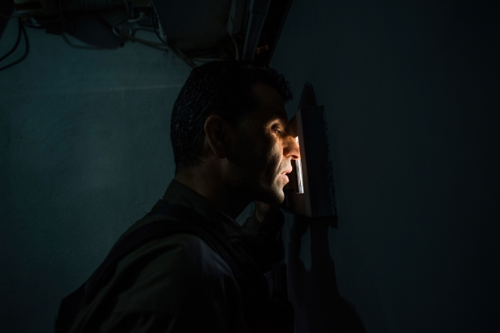 A guard looks out a window in a security door leading to the studios of Tolo News, Afghanistan's most popular television network, in Kabul on May 13, 2017.