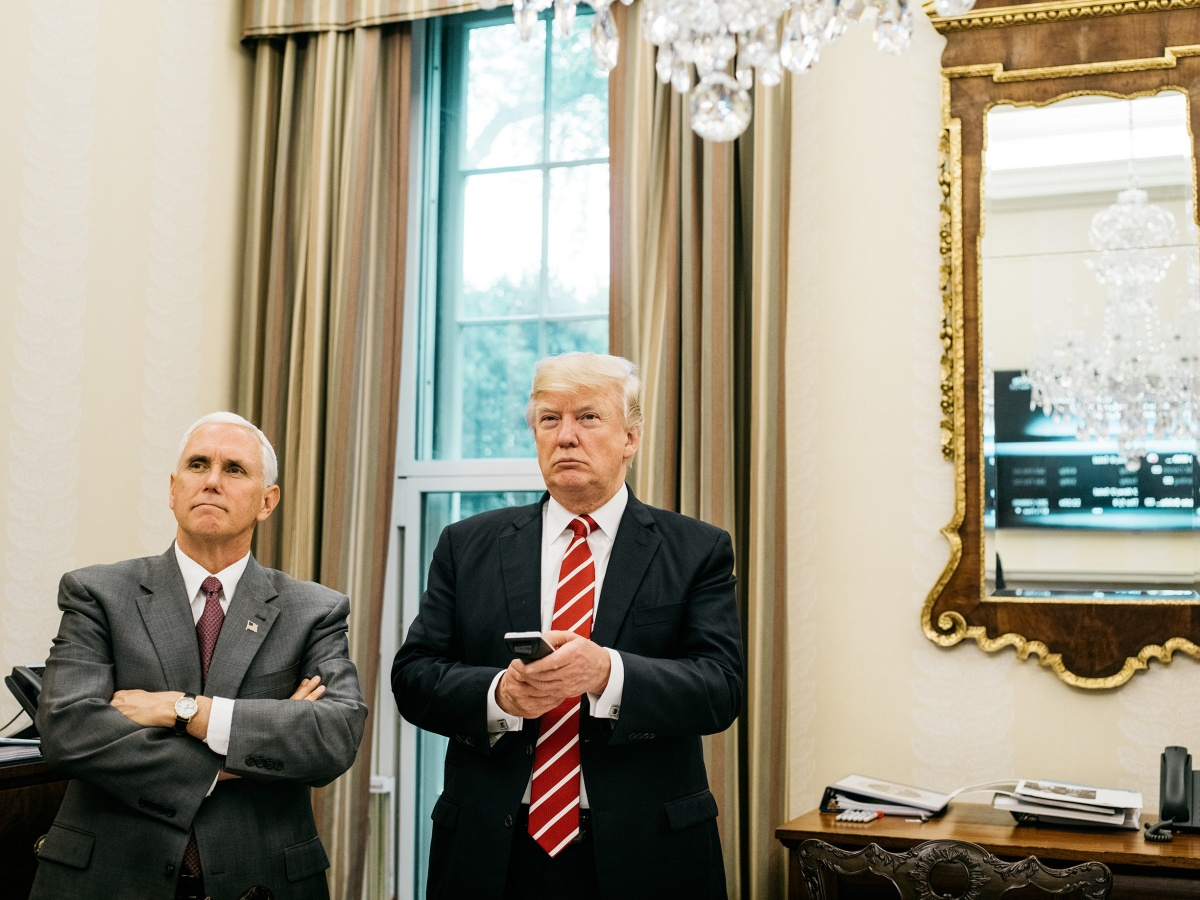 Trump, with Pence, watches a replay of Senate hearings from his private dining room near the Oval Office on May 8. Benjamin Rasmussen for TIME