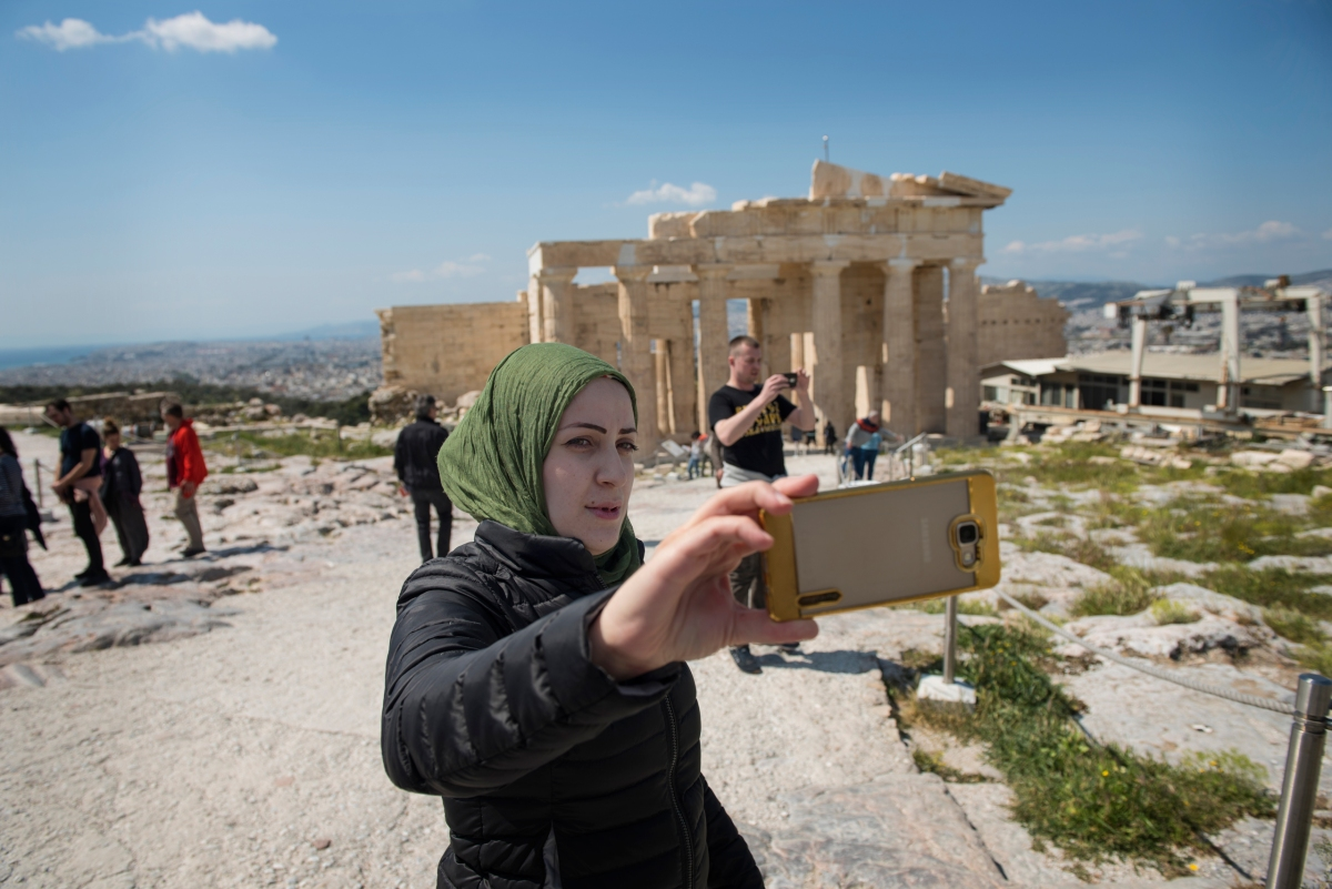 Syrian refugee, Taima, shoots a selfie while visiting the Acropolis in Athens, Greece, March 31, 2017.