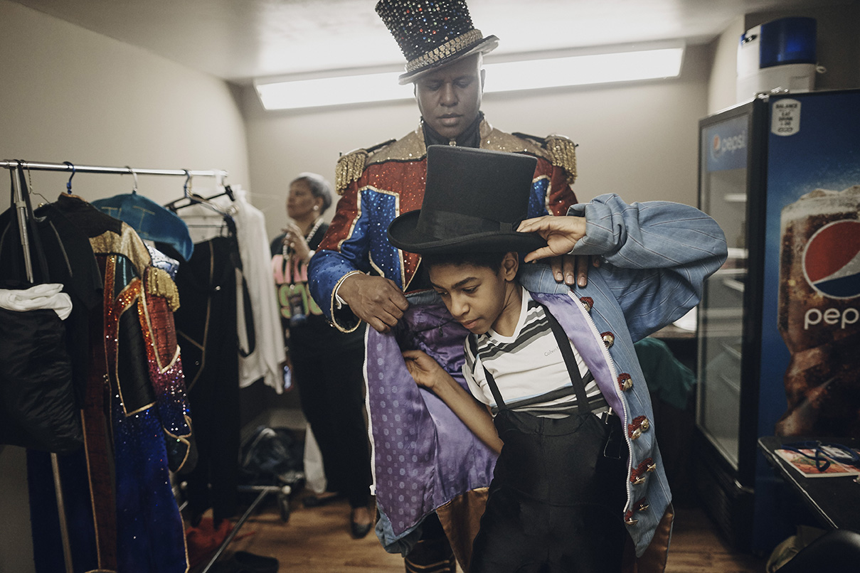Ringmaster Johnathan Lee Iverson and his son Matthew get ready for one of their final crowds in Baltimore, Maryland, Friday, April 28, 2017.
