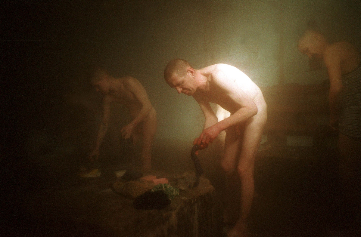 Putin's Russia - The Darkness of Russia March 2001 Siberia The Banya in Colony 33, Mariinsk. Outside temperatures are -35 degrees celsius, causing a constant stream inside where it is rather warm. Stanley Greene—NOOR