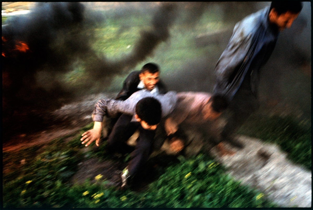 Iraq, Tikkirt, people running away from bombing, elevated view. Stanley Greene—NOOR