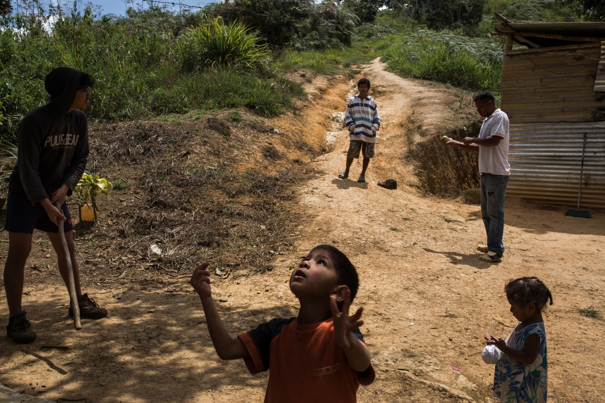 Family members play baseball out of their house in Turgua, a rural area near to Caracas, March 18, 2017. Wil Riera